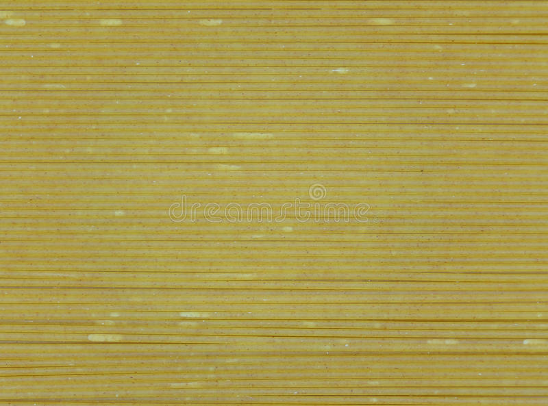 Close-up of Uncooked Whole Wheat Spaghetti, for Background royalty free stock image