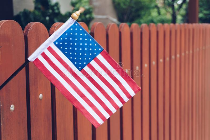 United States of America flag on brown wooden fence stock image