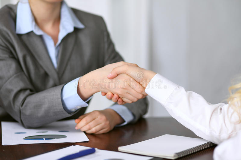 Close up of unknown business people handshake.  royalty free stock photos