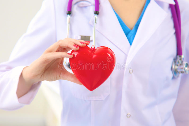 Close-up of unknown female doctor with stethoscope isolated.  stock photos