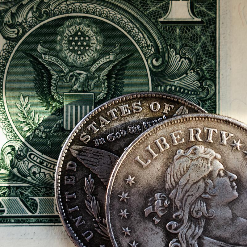 Close up US coins and one Dollar bill as symbol: America - the land of opportunities and freedom. Selective focus on word Liberty stock photos