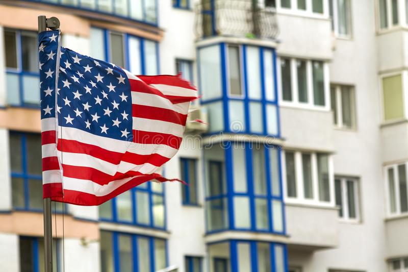 Close up of the us flag against city skyline.  royalty free stock images