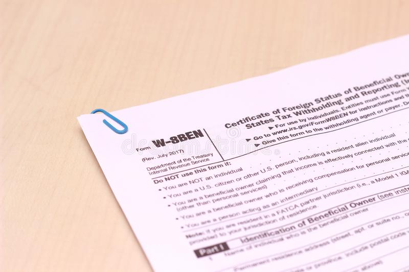 Close Up of USA Tax Form type W-8BEN, certificate of foreign status of beneficial owner for united states tax withholding. Photo close Up of USA Tax Form type W royalty free stock photos
