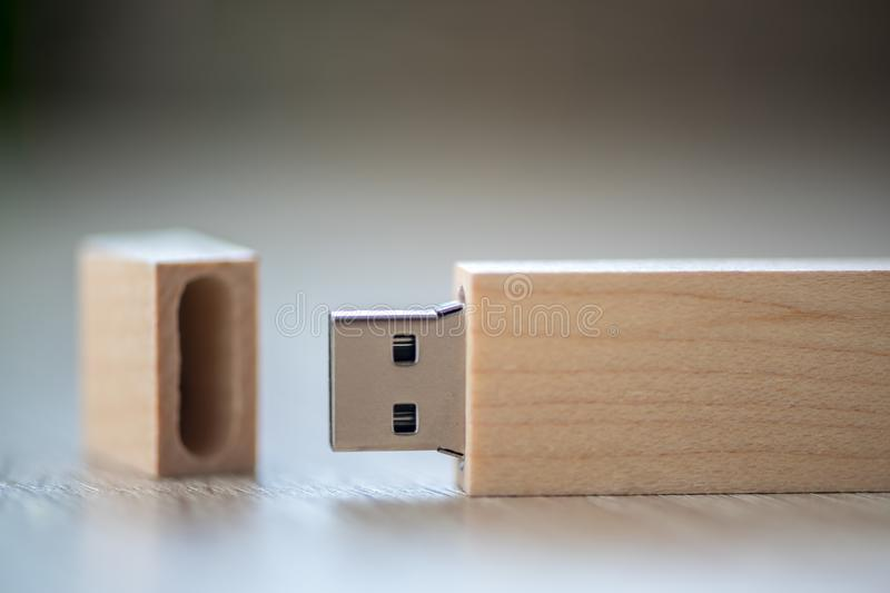 Close-up of a USB stick. Flash pen. Wooden case royalty free stock images