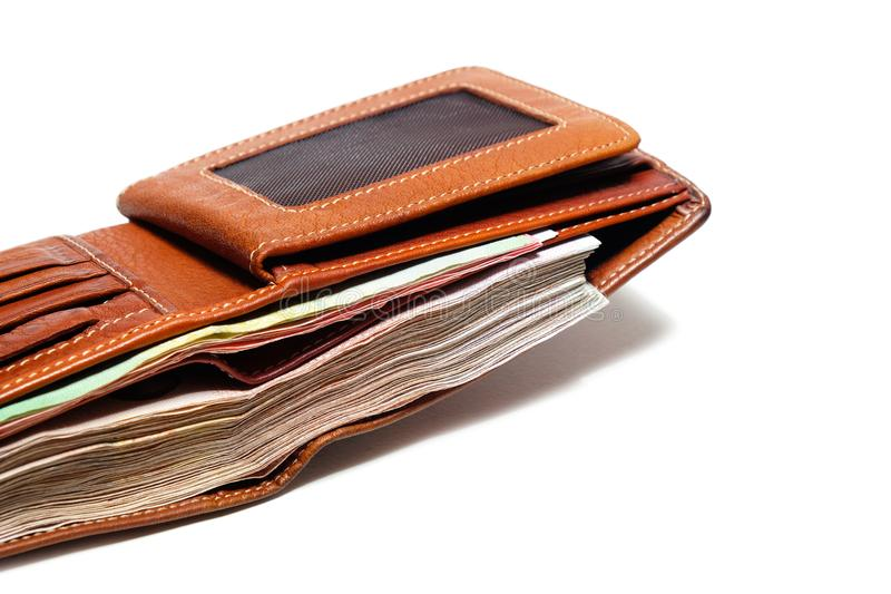 Close up Used Brown Leather Wallet with a full of banknote. stock photo