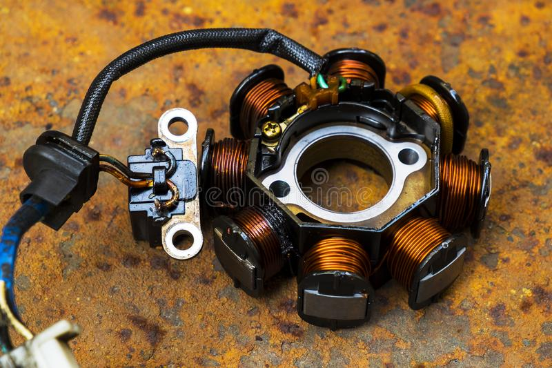 Close up of Used Motorcycle Stator. royalty free stock images