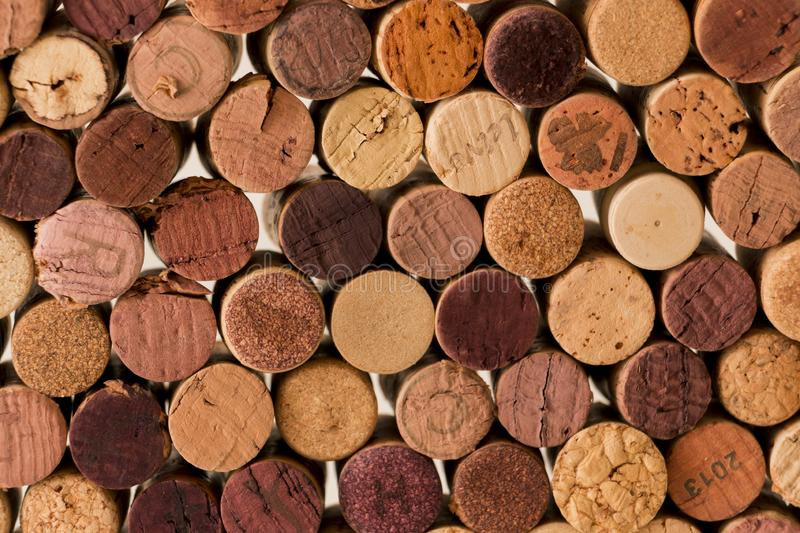 Close-up of used wine corks forming a pattern creating an original background stock image