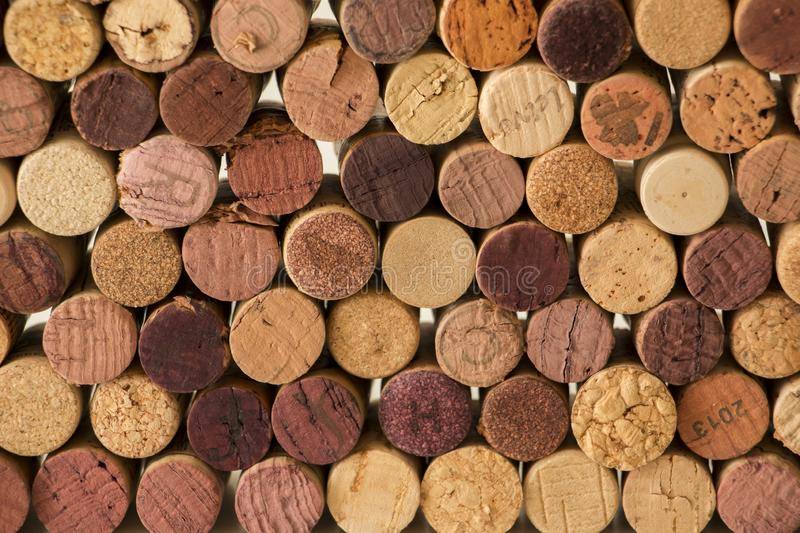 Close-up of used wine corks forming a pattern creating an original background. Close-up of used wine cork stoppers forming a pattern creating an original royalty free stock photo