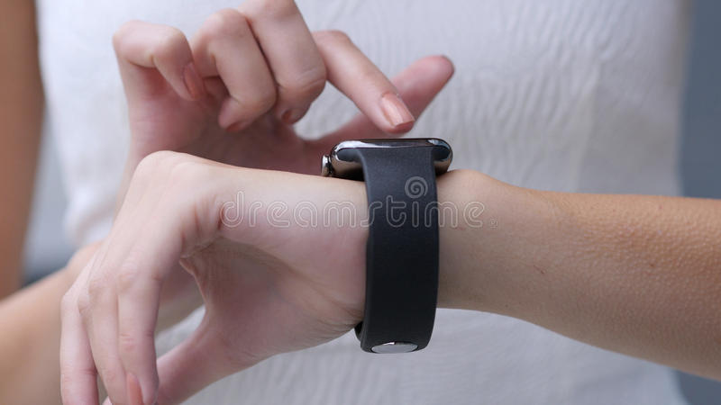 Close Up, Using Smartwatch by Beautiful Girl. High quality royalty free stock image