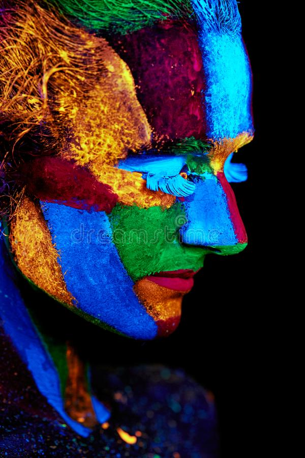 Close up UV abstract portrait. Halloween glowing royalty free stock photos