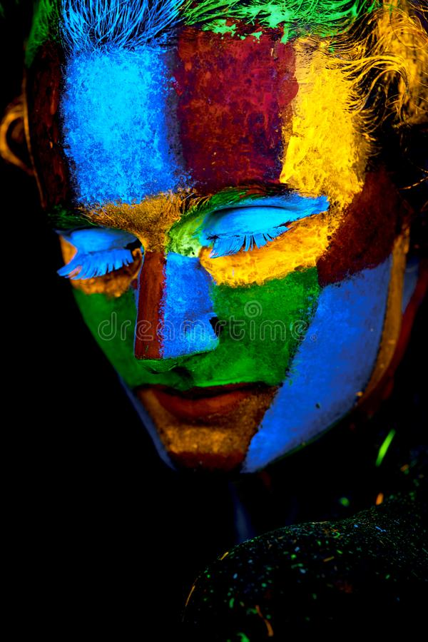 Close up UV abstract portrait. Halloween glowing stock photography