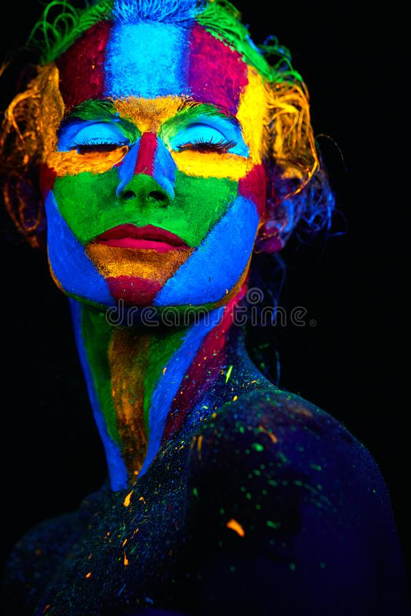 Close up UV abstract portrait. Halloween glowing stock image