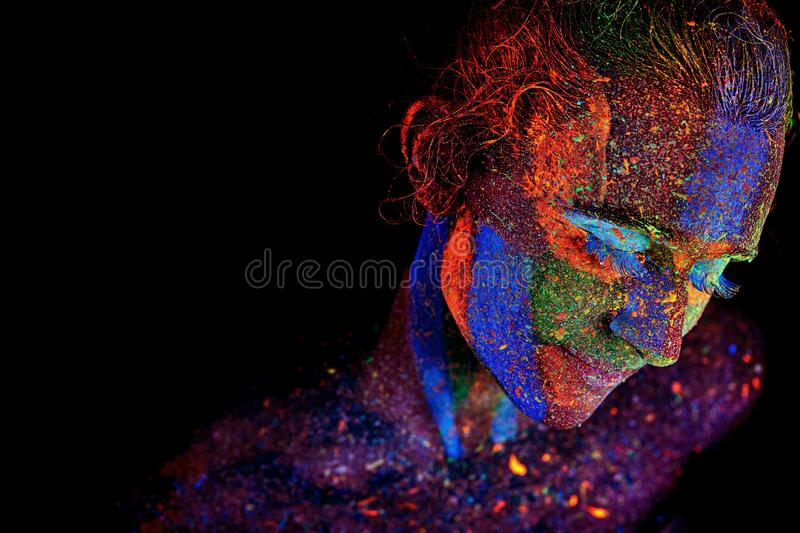 Close up UV abstract portrait. Halloween glowing stock photos