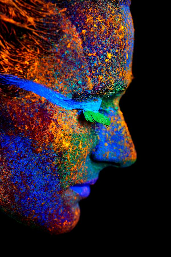 Close up UV abstract portrait. Halloween glowing stock images