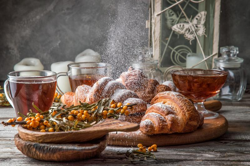 Close up. Valentine`s Day. Romantic breakfast with freshly baked french croissants, powdered on top white sugar powder stock photo
