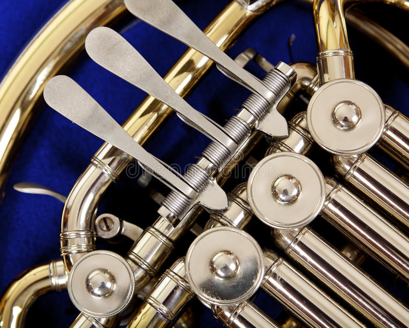 Close up of the valves and keys of a french horn stock photography