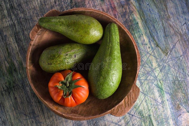 Close-up van avocadoverscheidenheid en erfgoedtomaat royalty-vrije stock foto