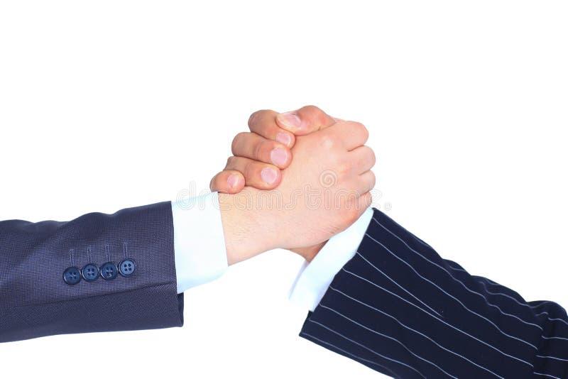 Close-up van bedrijfsmensen die handen schudden om hun vennootschap te bevestigen stock foto's
