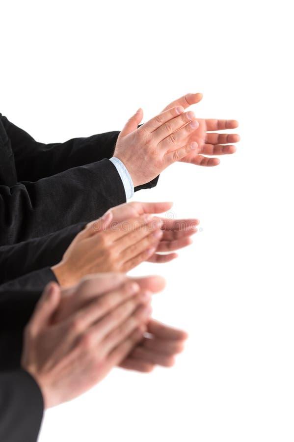 Close-up van bedrijfsmensenhanden die bij witte achtergrond toejuichen stock foto's