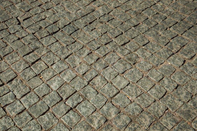 Close-up van bestrating van graniet setts op steeg wordt gemaakt die royalty-vrije stock afbeeldingen