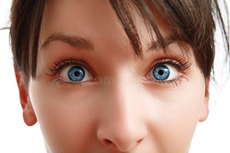 Close-up van blauwe ogen van jonge vrouw royalty-vrije stock fotografie