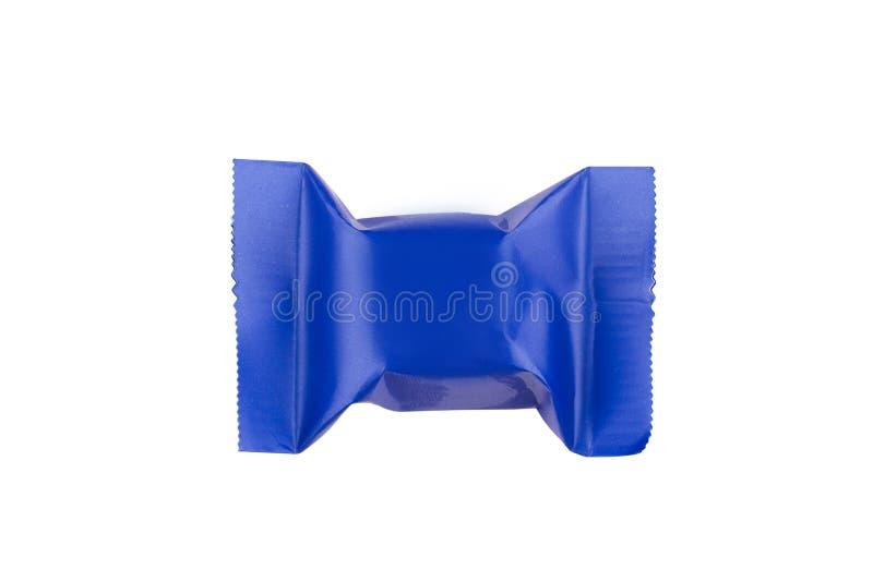 Close-up van chocoladereep in blauwe verpakking stock fotografie