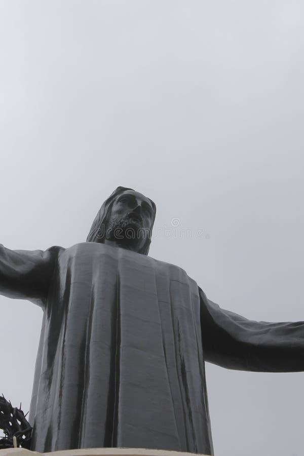 Close-up van Cristo Rey met open die wapens worden gezien van onderaan royalty-vrije stock afbeeldingen