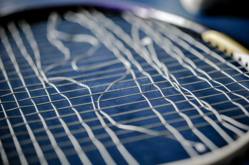 Close-up van de afwezigheid van de Badmintonracket met het badminton van de pendelhaan royalty-vrije stock foto's