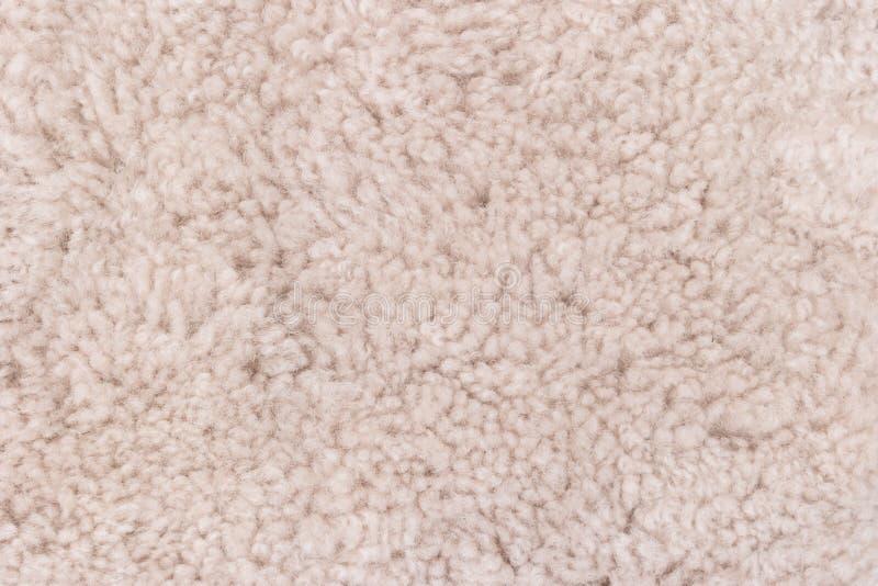 Close-up van de beige achtergrond van de tapijttextuur in de vergaderzaal royalty-vrije stock afbeelding