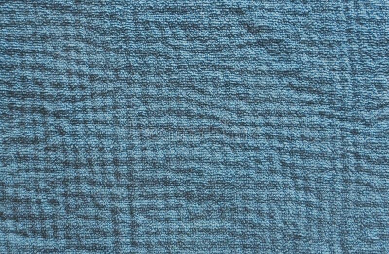 Close-up van de blauwe textieltextuur royalty-vrije stock afbeeldingen