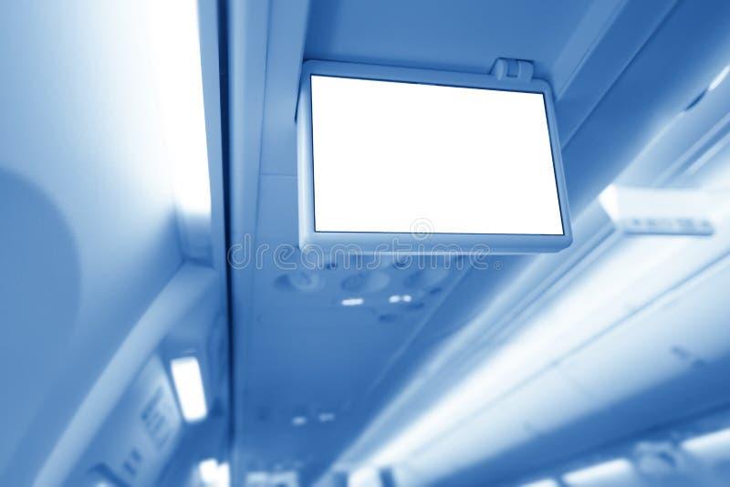 Close-up van de hand van de vliegtuigpassagier ` s het drukken een knoop om een stewardess te roepen stock fotografie