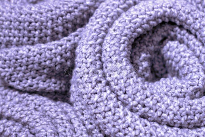 Close-up van de de in kleuren het wollen gebreide stof van het Krokusbloemblaadje, textuur, achtergrond stock afbeeldingen