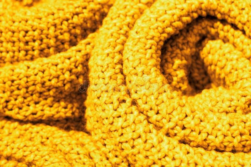 Close-up van de de kleuren wollen gebreide stof van in Ceylon het gele, textuur, achtergrond royalty-vrije stock afbeelding