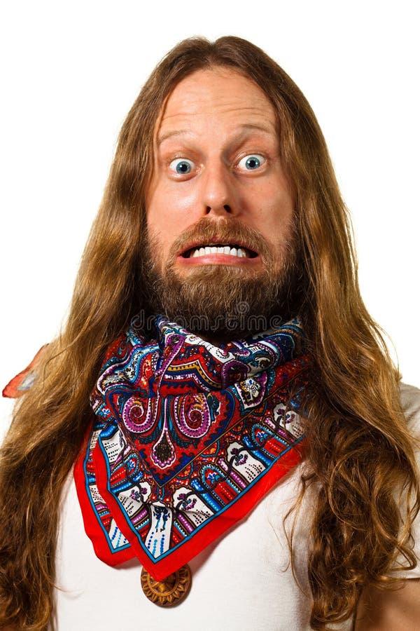 Close-up van een hippiemens met een gekke uitdrukking. stock fotografie