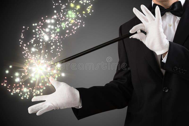 Close-up van een Toverstokje van Tovenaarcreating sparkles with royalty-vrije stock afbeelding