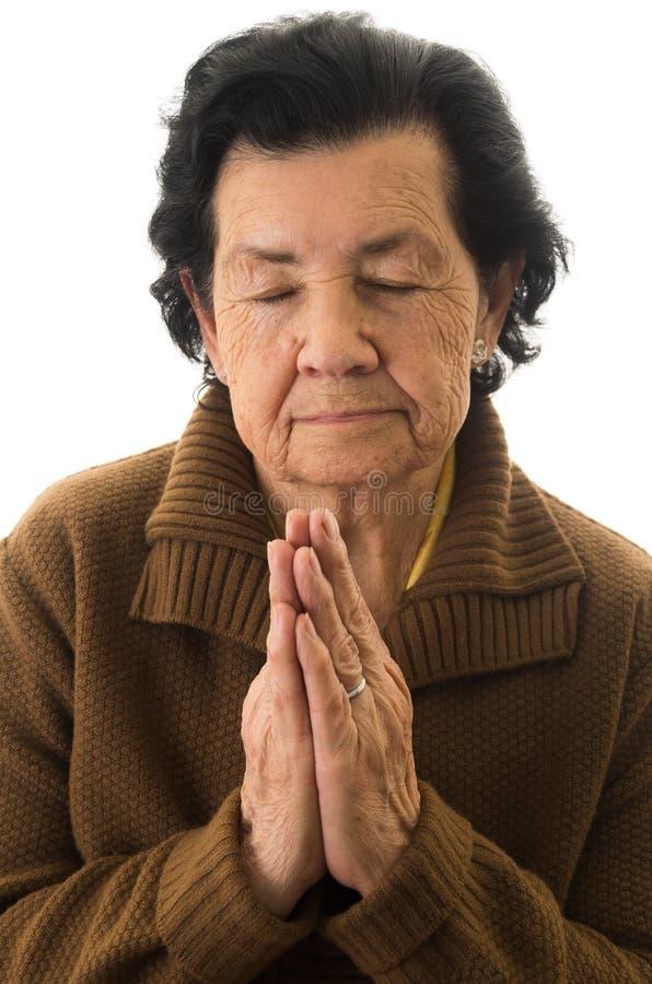 Close-up van grootmoeder het bidden wordt geschoten die royalty-vrije stock foto's