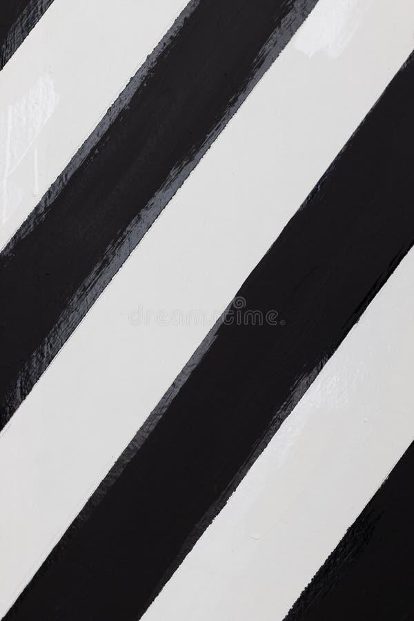 Close-up van houten die plank door visgraat zwart-witte kleur wordt geschilderd stock afbeeldingen