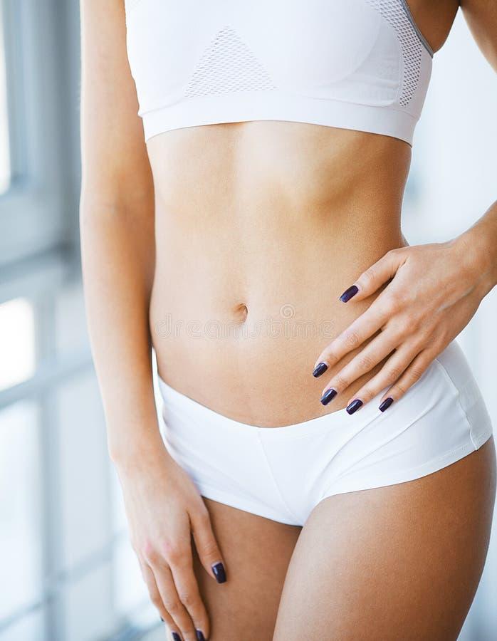 Close-up van Mooi Slank Vrouwenlichaam met Sexy Billen, Grote Ezel stock fotografie