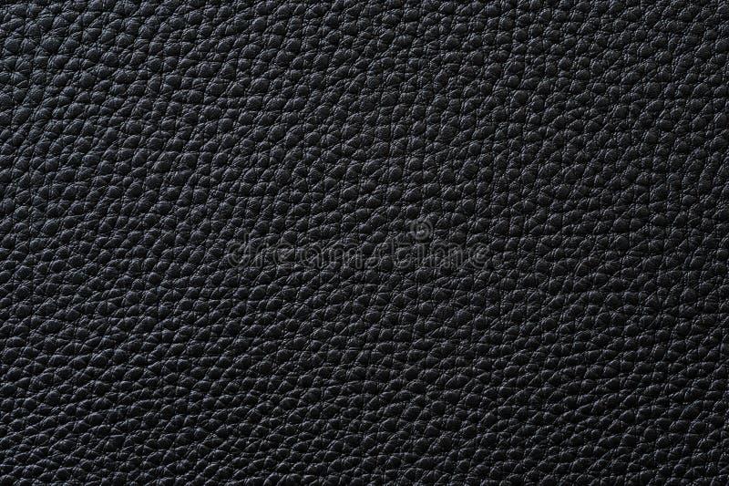 Close-up van naadloze zwarte leertextuur stock fotografie
