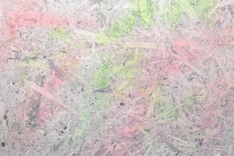 Close-up van pressboardachtergrond met groen roze stock afbeelding