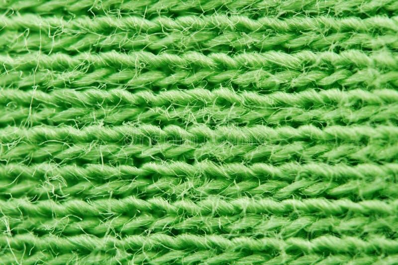 Close-up van textuurstof Groene doek textielachtergrond Macr royalty-vrije stock fotografie