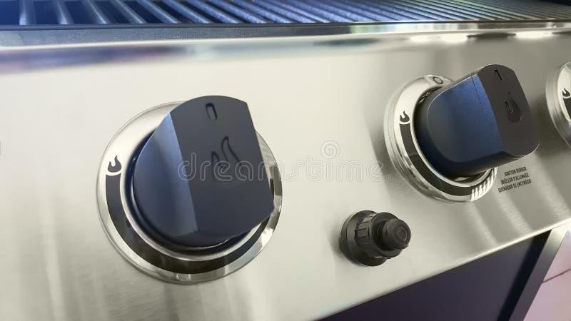 Close-up van Vier van de de Barbecuegrill van het Brandergas de controleknoppen stock foto