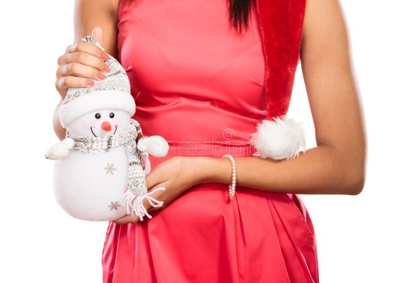 Close-up van vrouw met weinig sneeuwman Kerstmis stock afbeeldingen