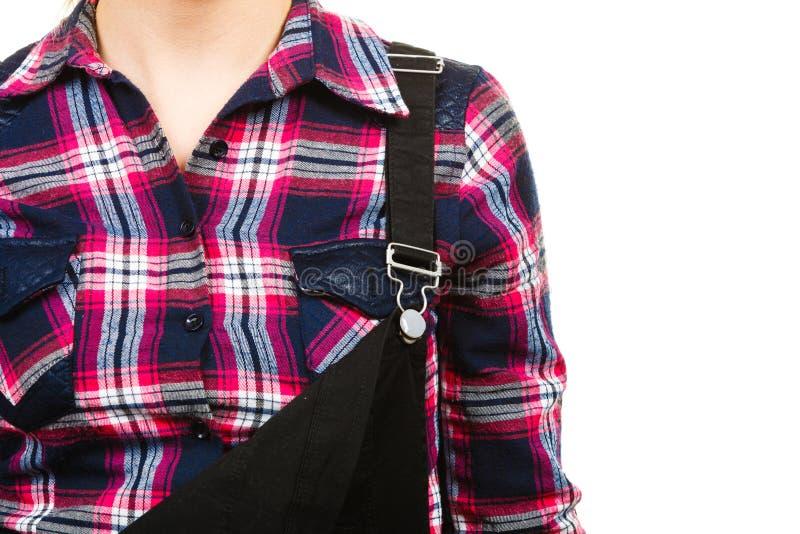 Close-up van zwart grove calico's en overhemd op vrouw royalty-vrije stock afbeelding