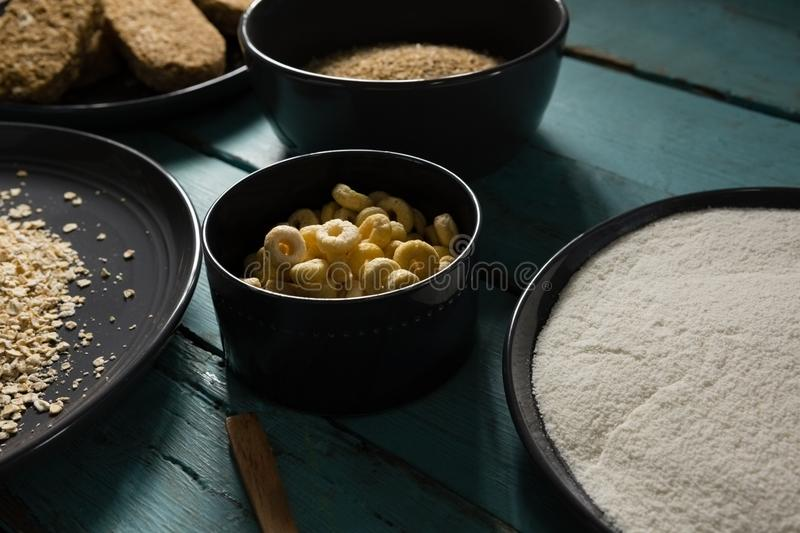 Bowls of various breakfast cereals stock images