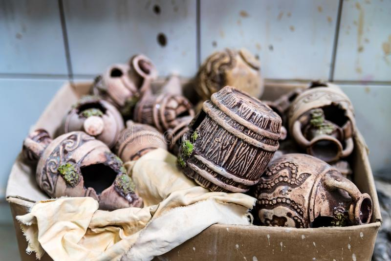 Various clay items in box. Pottery workshop stock image