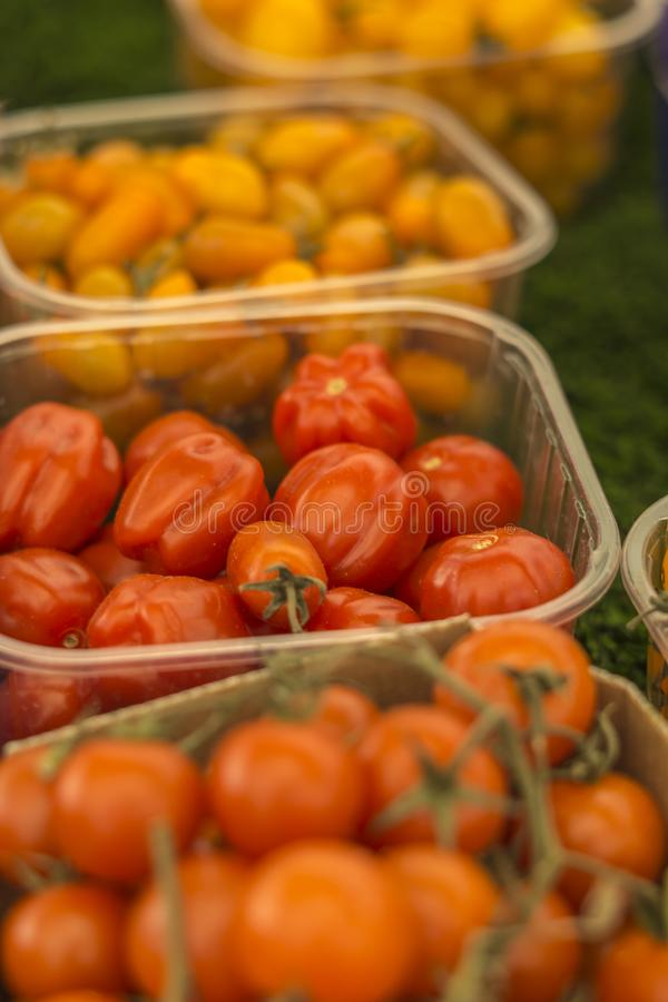 Close up of various types of little tomatoes.  stock photography
