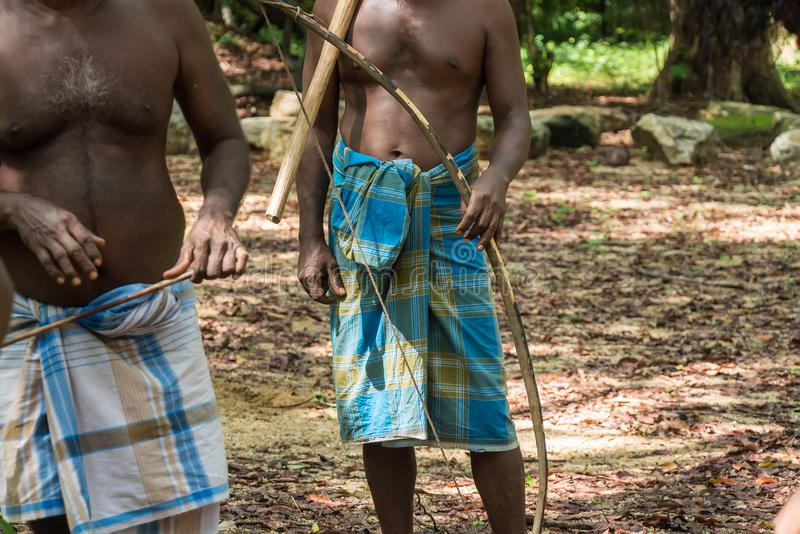 Close up of Vedda people. Closeup of Vedda men standing in group in waistcloths royalty free stock images