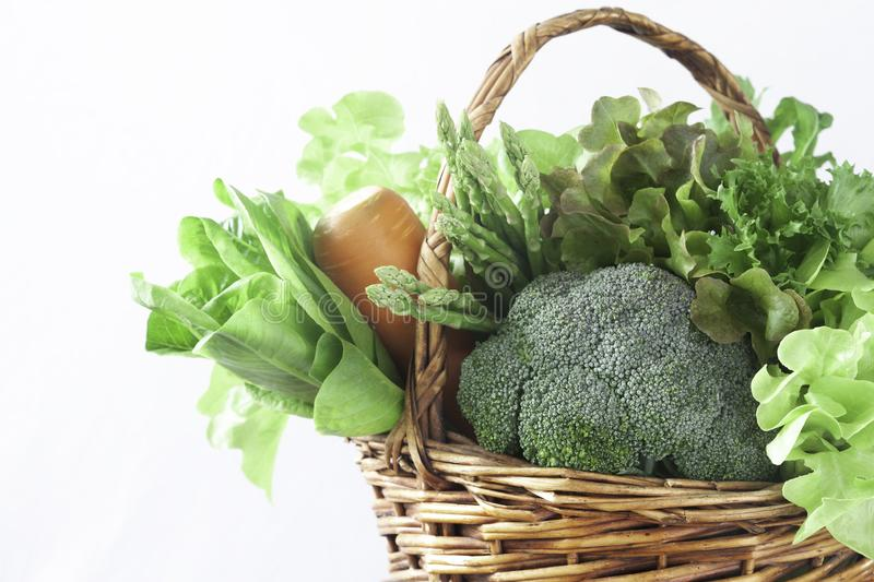 Close up vegetables in basket on white background, Healthy lifestyle concept stock photography