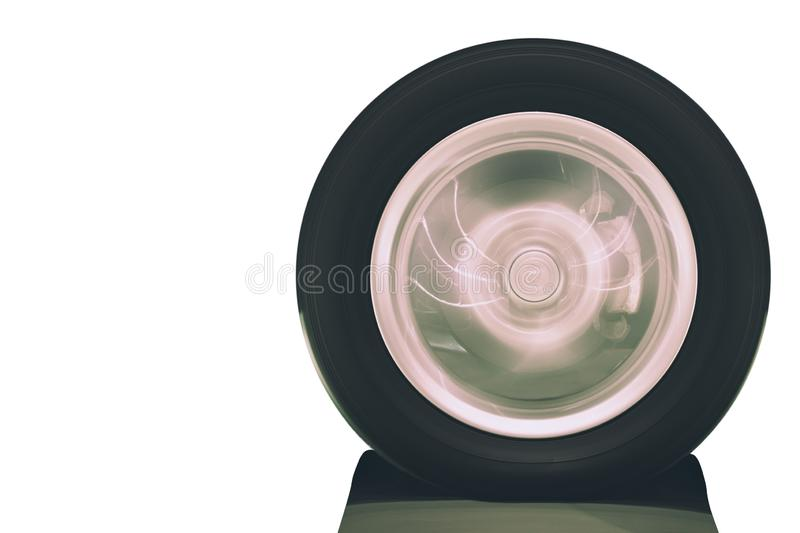 Close up of vehicle wheel rotation on road with blurry motion on white background stock photo